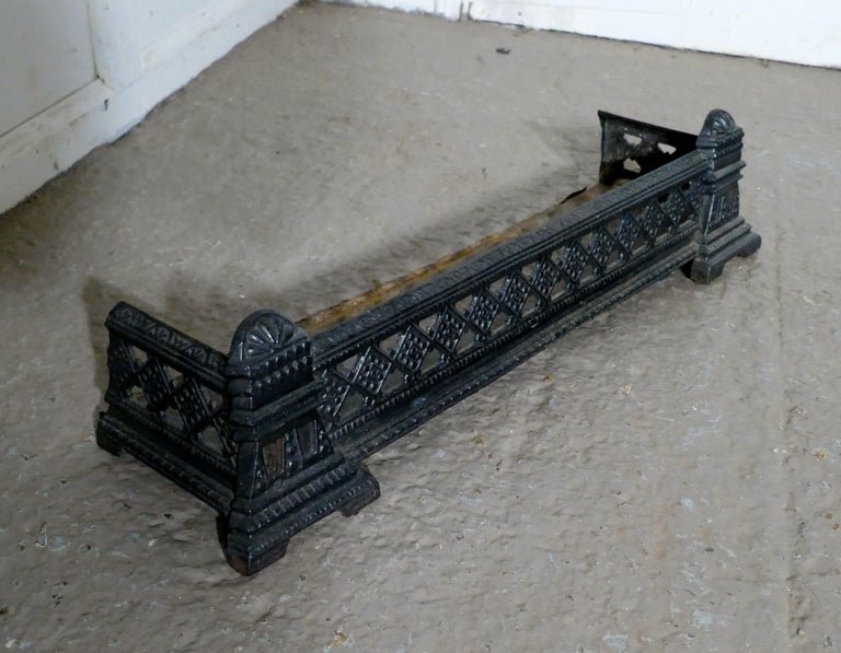 Small Victorian cast iron fender or dog grate  This is a good Victorian fender it is best quality and heavy, fenders like this were known a Dog Grates as they serve to rest the fire tools and keep any rolling ash in check The fender is in good