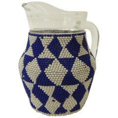 Small Vintage Glass Milk Jug with Handcrafted Artisanal Woven Beaded Cover