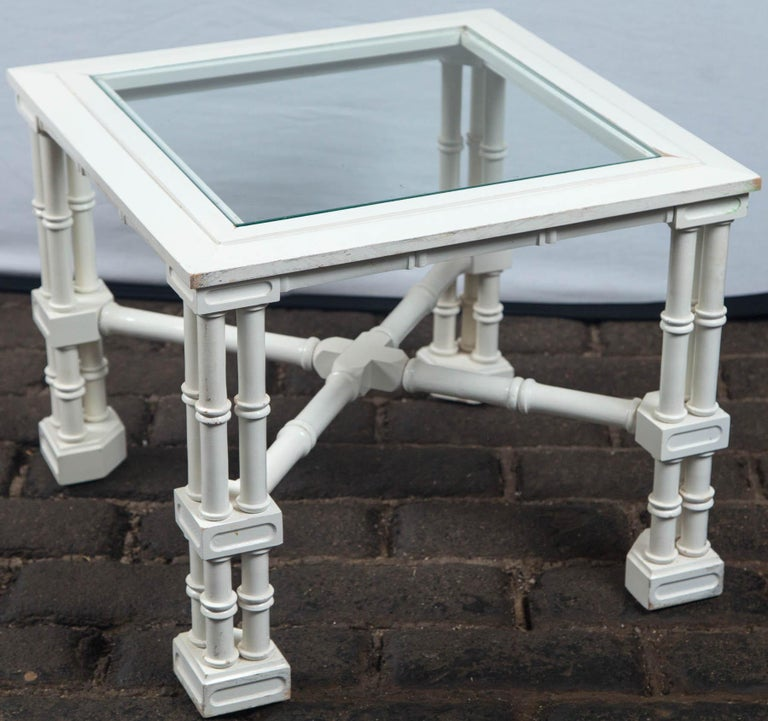 Small square white painted faux bamboo, fretwork table with a glass top. Nice detail, from the 1970s, Asian style.