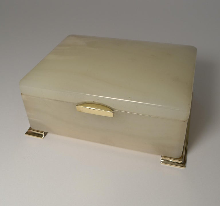A very elegant box in white onyx with polished bronze fittings.  The box opens to reveal the signature for the well renowned London Patentees and Makers, George Betjemann. Marked on the hinge Betjemann's Patent 449335, made in England; the box