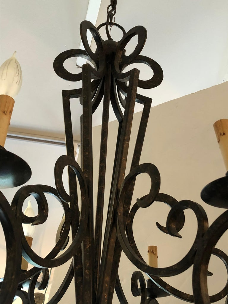 American Smashing Dark Brown and Gilded Wrought Iron Chandelier For Sale
