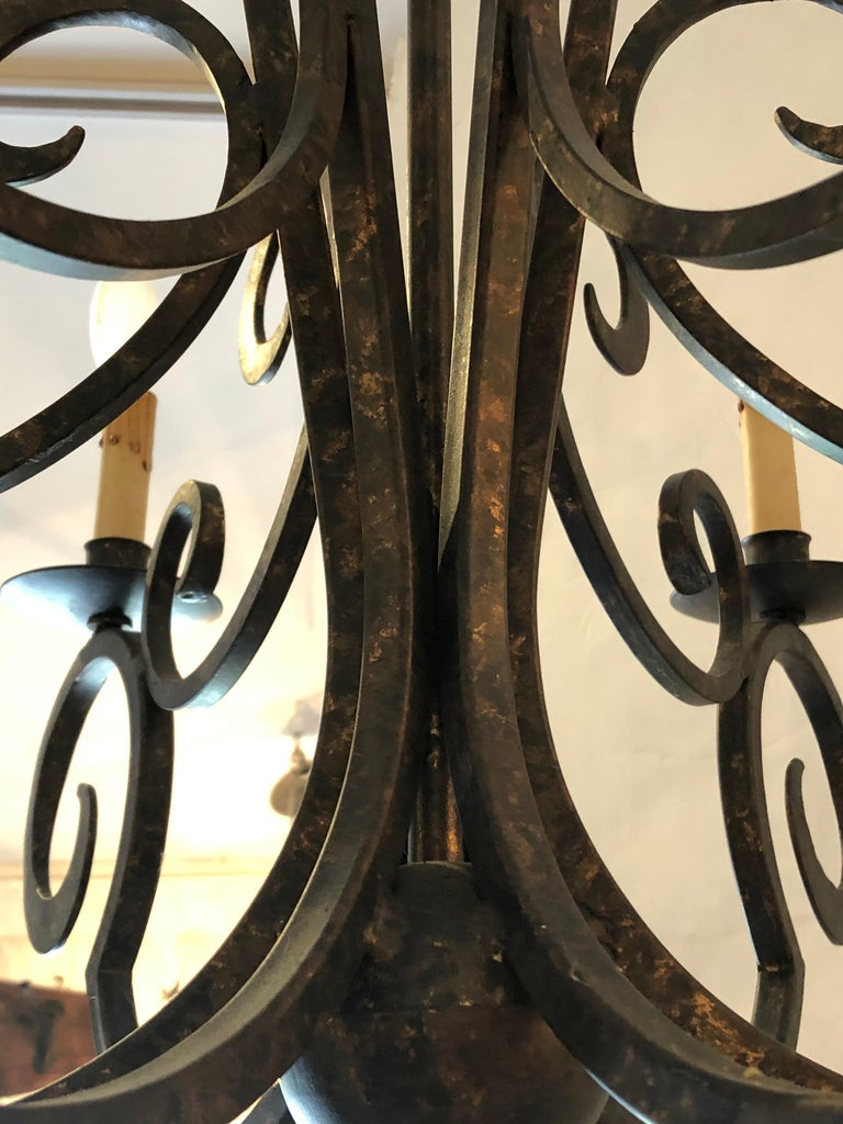 Smashing Dark Brown and Gilded Wrought Iron Chandelier In Excellent Condition For Sale In Hopewell, NJ