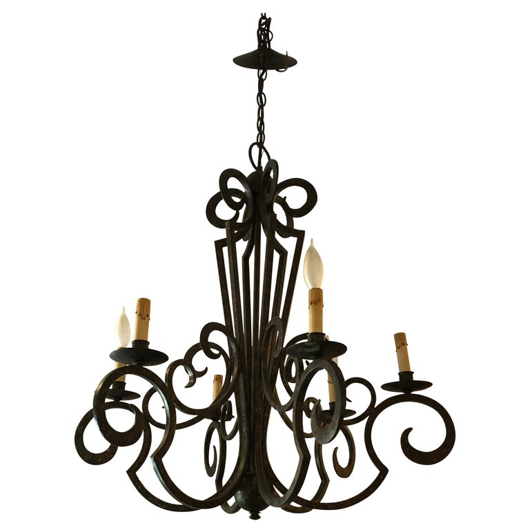 Smashing Dark Brown and Gilded Wrought Iron Chandelier For Sale