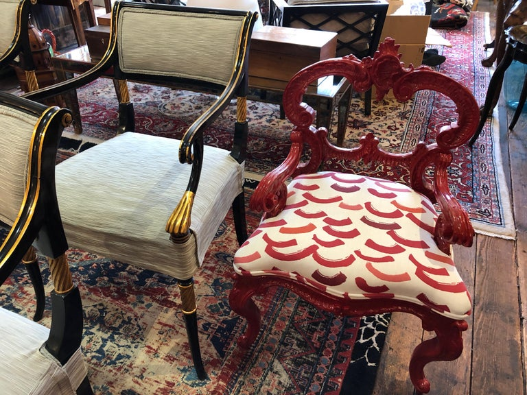 High design in a small package is how we describe this super chic designer small chair having a cherry red shiny laquer Rococo frame and new contemporary graphic upholstery on the seat. Measures: Seat height 16, seat depth 16.5.