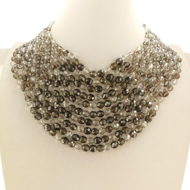 A beautiful, softly hued necklace, consisting of ten rows of smokey quartz, taupe and clear half crystal faceted beads , in varying sizes, from Coppola e Toppo, from 1962 -64. Ten string-mounted rows are attached to weft - mounting or 'weaving',
