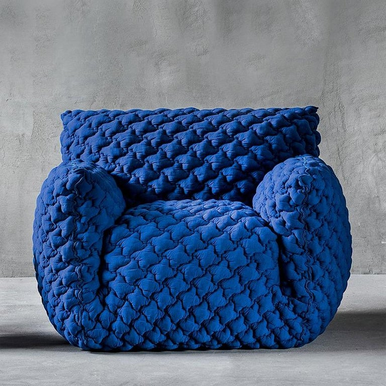 Armchair lounge smooth blue upholstered with foam in polyurethane covered by a polyester fibre quilting and a goose down. Removable cover. Measures: L 90 x D 80 x H 75, seat height 42 cm. Price: 4950,00€ L 145 x D 110 x H 85, seat height 48 cm.