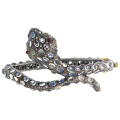 Snake Bangle in Gold and Silver with Diamonds and Moonstone
