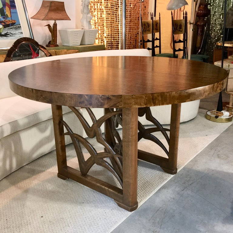 Italian American modernist design expandable round dining table by Adolfo Genovese of F. & G. Handmade Furniture Co. 121 First Street East Cambridge, MA. This table was made late 1940s-early 1950s. The base is a walnut N- or Z- form frame of three