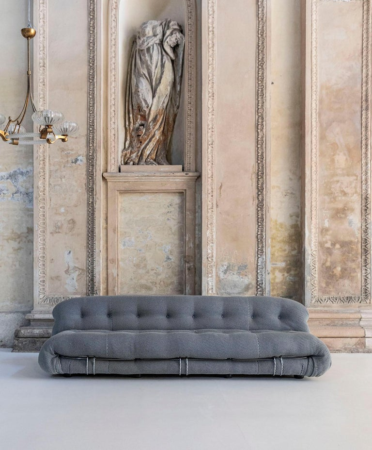 Sofa and armchair in metal structure with original gray/light blue fabric. Modern style from a production period: 1960-1979. This sofa won the Compasso d'Oro award in 1970.