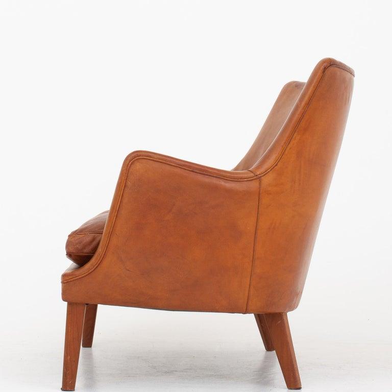 AV 53/2 - Sofa in patinated natural leather with legs in teak. Maker Ivan Schlechter.