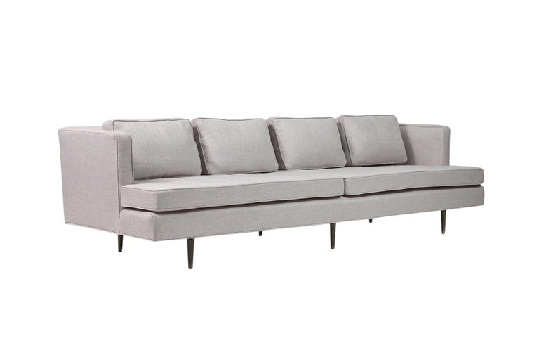 Sofa by Edward Wormley for Dunbar with brass legs. Model 4906 Sofa has been recently and expertly reupholstered.