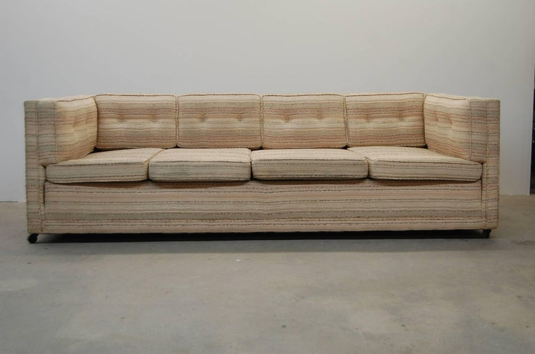 Large sofa, designed by William Pahlmann, circa 1955. The back and side cushions are fix, as opposed to loose, and the seat cushions slide underneath them. Sofa is on small wheels. Fabric appears to be the original, and the condition is very good