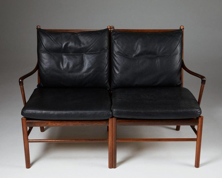 Brazilian rosewood and black leather.