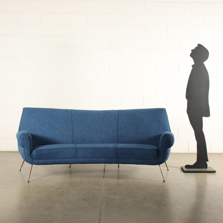 Three-seat bean-shaped sofa. Spring and foam padding, fabric upholstery, brass legs.