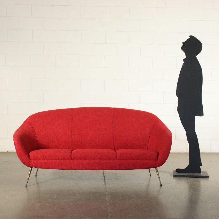 Three seater sofa. Foam padding, fabric upholstery, brass-plated metal legs.