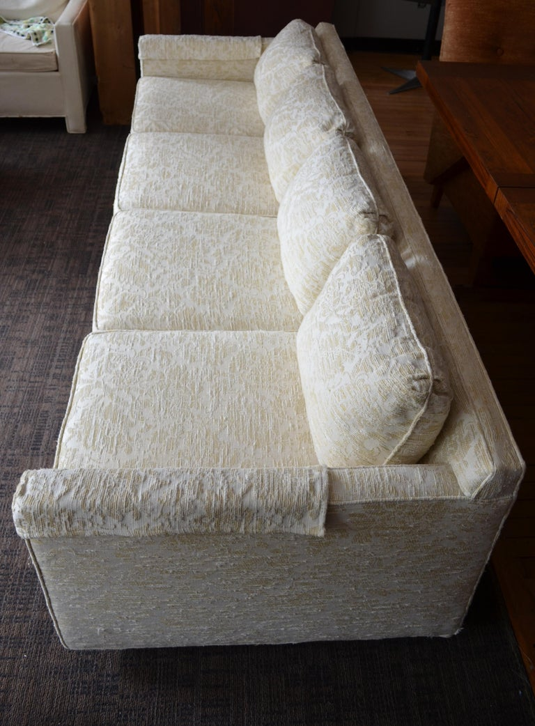 Mid-century sofa from Flair. Upholstered in blended cotton felt. Eight-foot width on six pivoting casters. Moves around with the grace of a ballroom dance. Rarely used in excellent vintage condition. Structurally solid, tight springs and firm