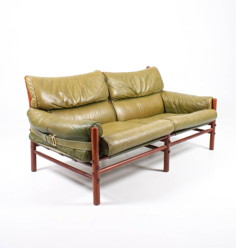 Sofa in patinated green leather and solid wood frame. designed by Arne Norell for Norell Møbel AB in the mid-1960s. A Very comfortable sofa in timeless design and quality. Made in Sweden.