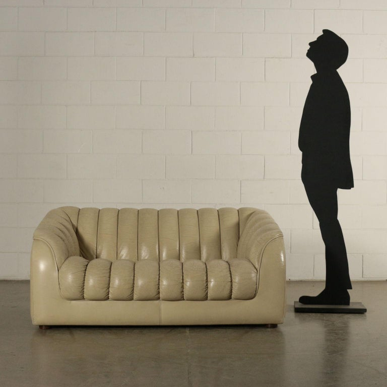 Two-seat sofa, foam padding, leatherette upholstery.