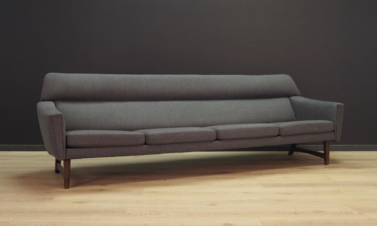 Fantastic sofa from the 1960s-1970s, Scandinavian design. Upholstery after replacement in grey fabric. Construction is made of solid wood. Maintained in good condition (minor bruises and scratches), directly for use.  Dimensions: height 76 cm,