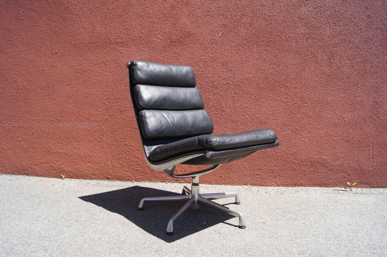 Charles and Ray Eames designed the soft pad series for Herman Miller in 1969 to complement their lounge chair and chaise. An example of the armless version of the executive chair, this features a high-back aluminum frame upholstered in black leather