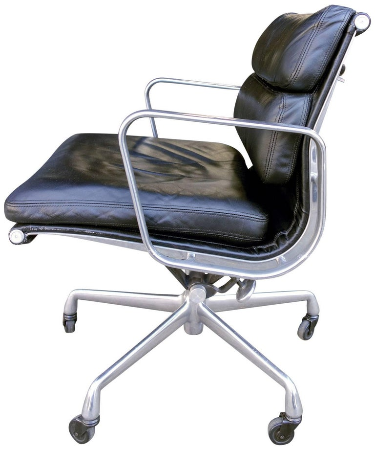 For your consideration we have Eames for Herman Miller vintage soft pad chairs in black leather with low backs. 