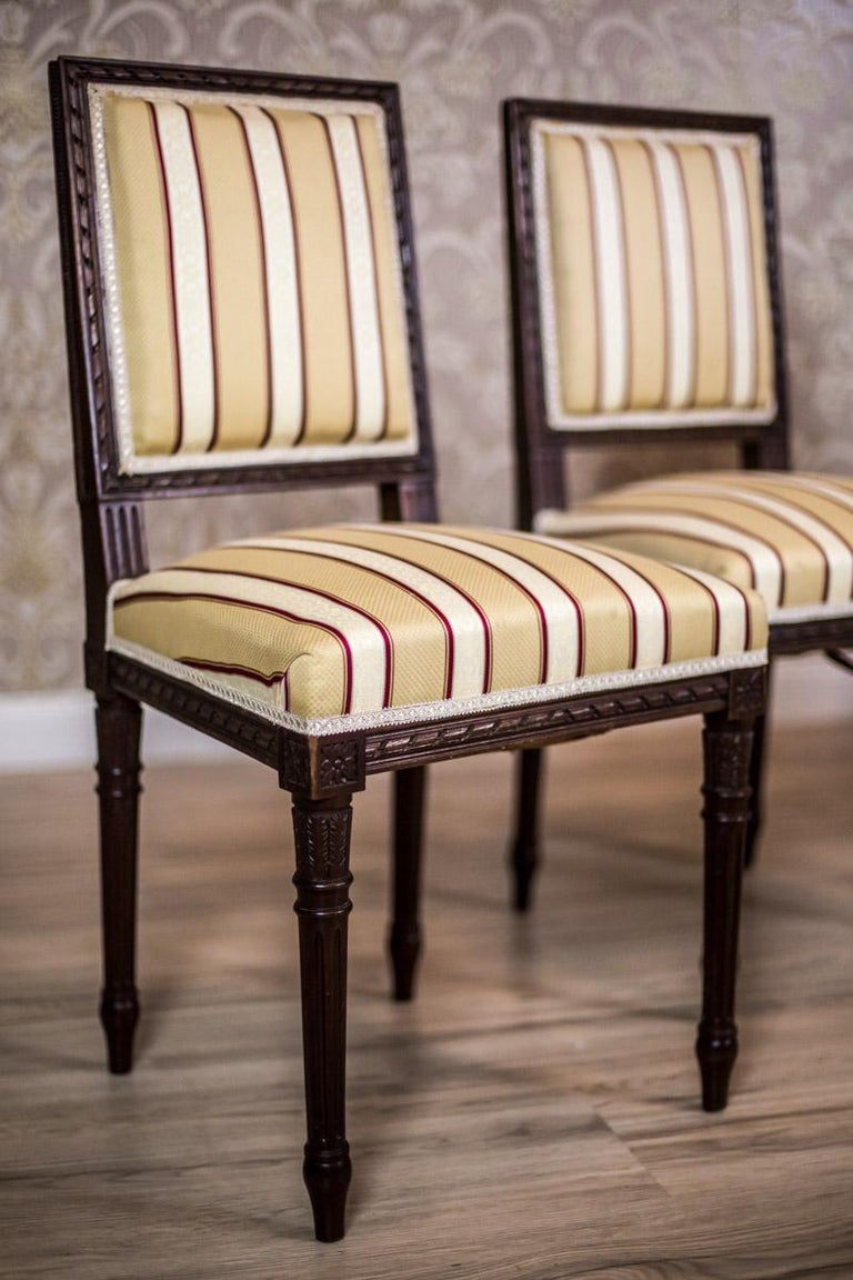 We present you this set of four chairs with softly upholstered backrests and spring seats. The furniture is circa the early 20th century; refers to the neoclassicist forms from the second half of the 18th century in the Louis XVI style. The square