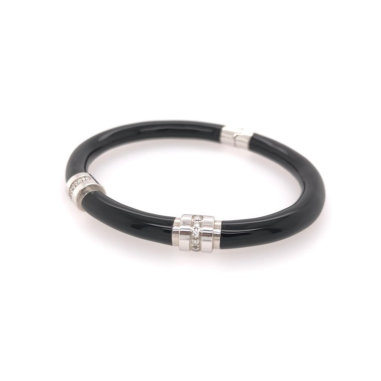 SOHO sterling silver black enamel bracelet with two diamond stations.  Total diamond carat weight: 0.16 CT  Stamped: SOHO SLVR
