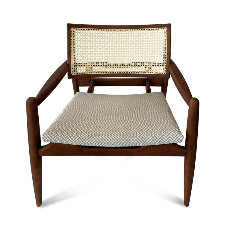 The soho features a slightly declined seat and incorporates great shaping in the cane back and spindle legs. Please do not overlook the belt buckle supports in the back of this beautiful chair!  In stock!!!