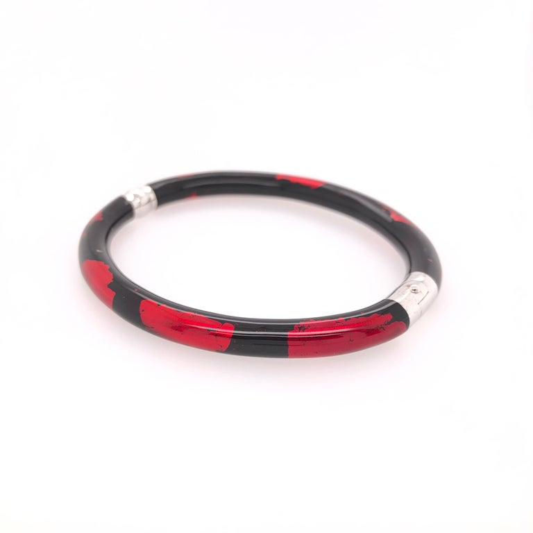 SOHO sterling silver red and black foliage bangle. A wonder complement to your day wear or a night on the town!  Stamped: SOHO SLVR