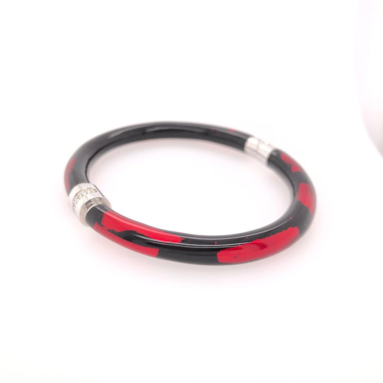 SOHO Sterling Silver and Enamel Red and Black Foliage Bangle with Diamonds.  Total diamond carat weight: 0.08CT  Stamped: SOHO SLVR