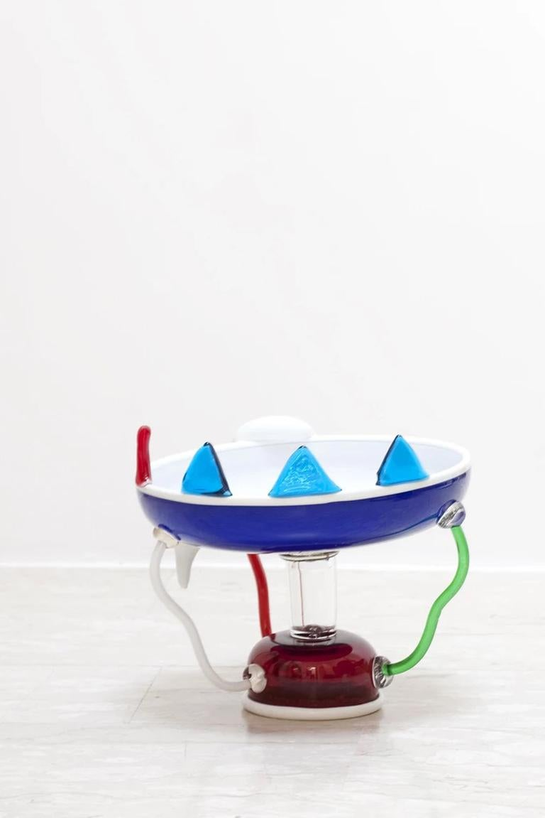 The Sol glass fruit bowl was originally designed by Ettore Sottsass in 1982. Signed on the base, for further information please see authenticity info below.  Ettore Sottsass was born in Innsbruck in 1917. In 1939 he graduated in architecture at