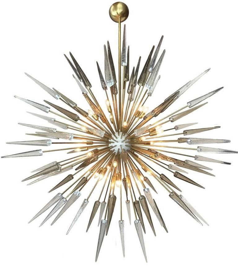 Italian Sputnik chandelier shown in clear and smoky Murano glass shards with matte white enameled centre on natural brass frame by Fabio Bergomi for Fabio Ltd / Made in Italy This fixture is fully customizable with various glass colors and metal