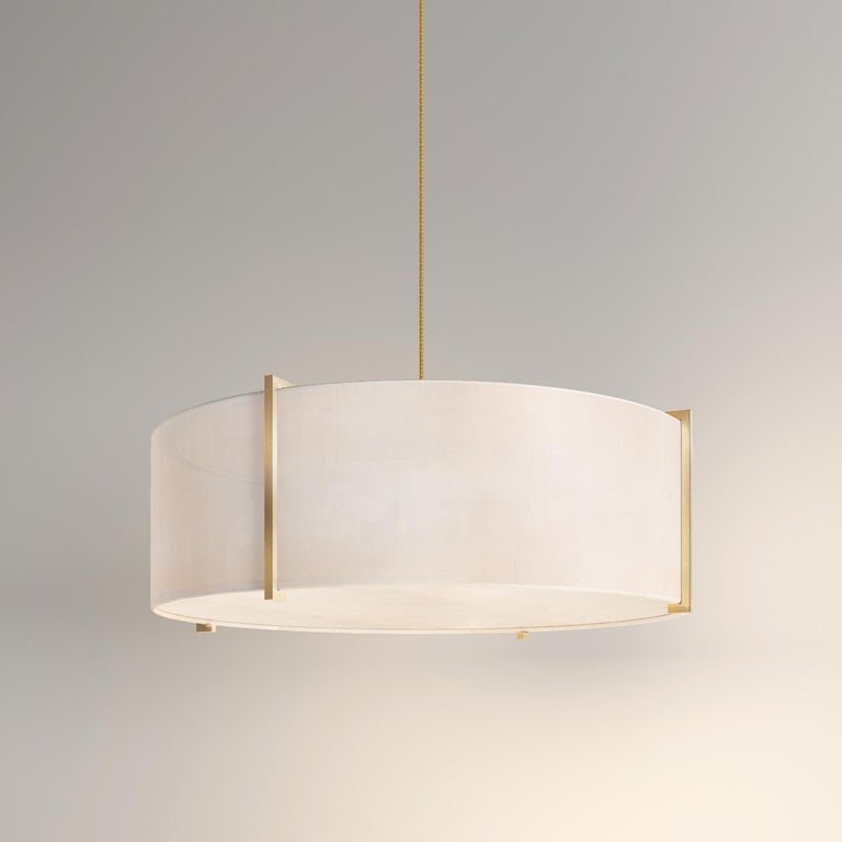 A gorgeous example of a neutral, exquisitely finished pendant from our 'Canvas Collection'. 'Soleil' pendant light features pure, raw silk shades set in a contemporary frame.  This purist pendant is apt for both modern and classic interiors. The