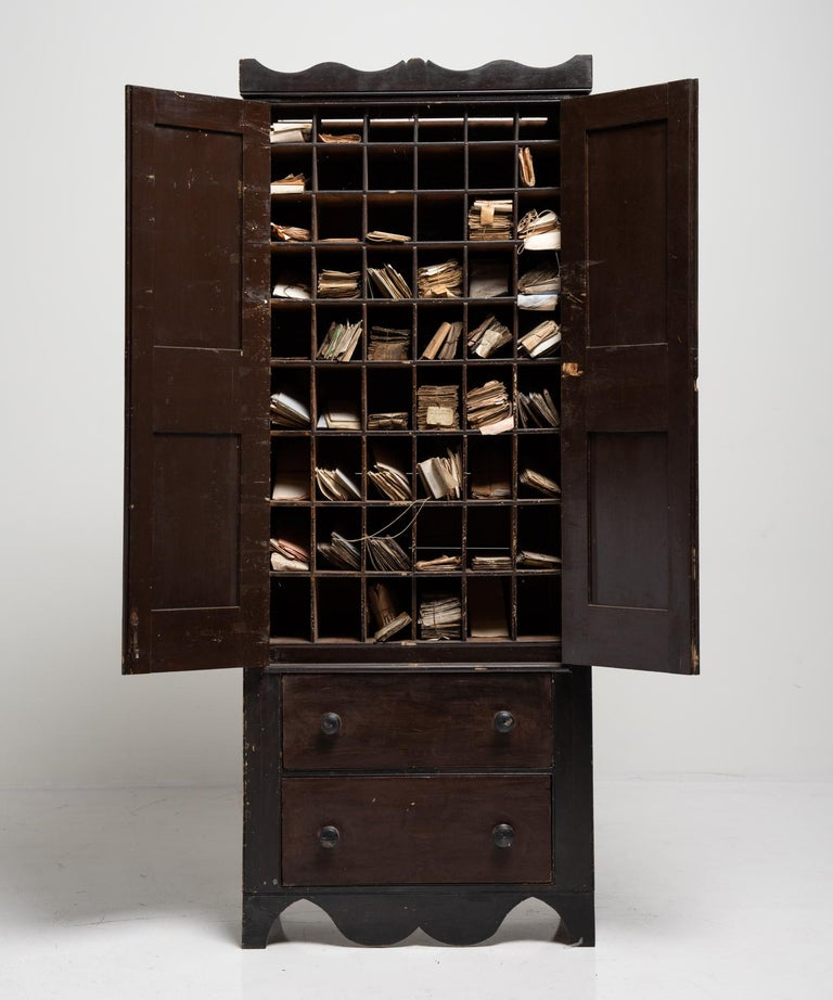 Solicitors cabinet, England, 19th century.  Painted carved wooden cabinet. Filled with hand written legal documents from the 20th century. Documents included.