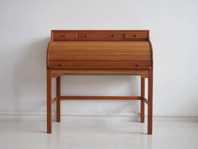 Andreas Hansen writing desk or secretary made of solid American cherrywood. Designed in 1979. Manufactured by Hadsten Wood Industry. Top part with three small drawers, front with tambour door, behind which are small compartments and drawers.