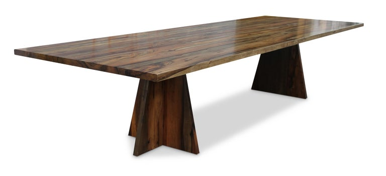 The Luca table is one of Costantini's signature and most specified pieces. It is shown in Argentine Rosewood finish, and is extremely colorful and durable. The design itself is understated and architectural in nature and lets the material take