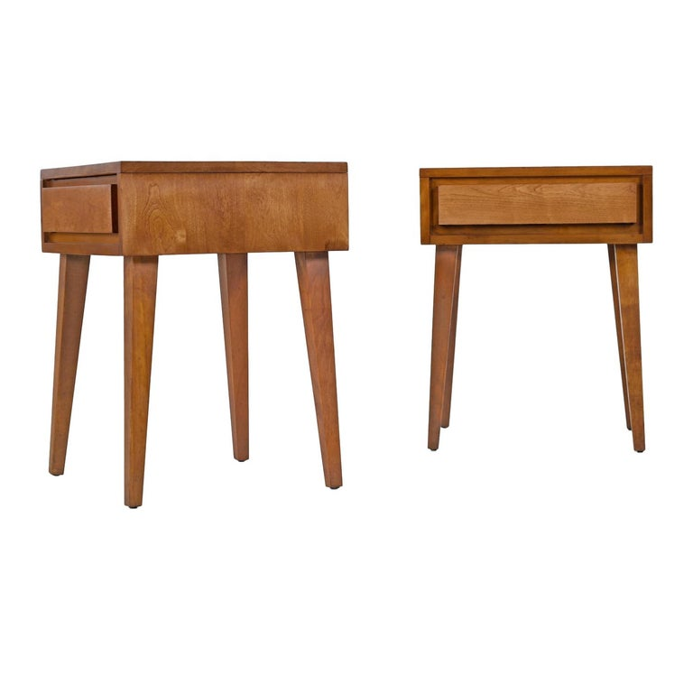 Pair of Mid-Century Modern nightstands / end tables designed by 20th century American furniture luminary Leslie Diamond. Constructed of solid birch wood with architectural clean lines. This is a handsome piece from Conant Ball's Modernmates