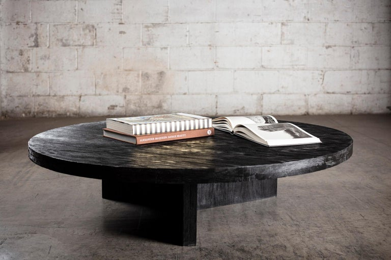 This solid wood coffee table is handcrafted of wood that retains its natural character, bearing the occasional knot, nick or crack where no two tables are exactly the same.