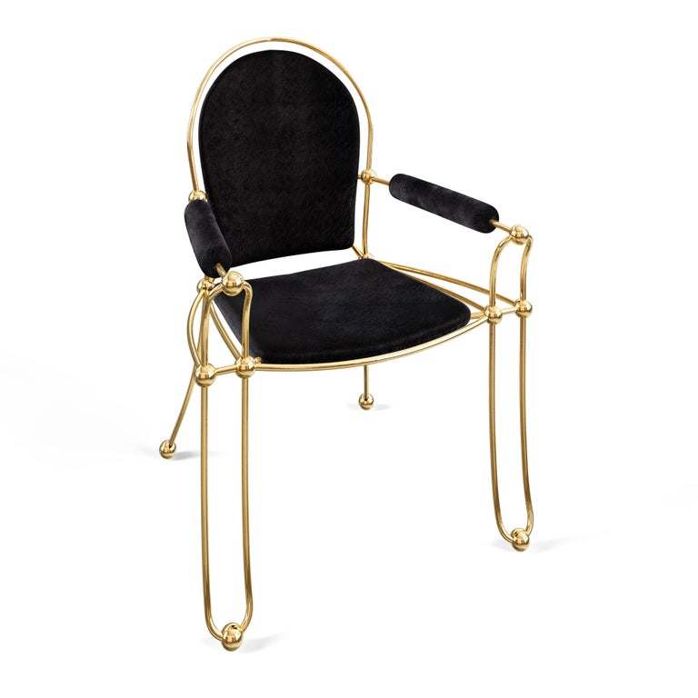 The 2 for 1 Chair has contemporary modern lines with old world comfort and silhouette. Designed with beautiful proportion and scale the 2 for 1 chair has traditional craftsmanship with modern contemporary style.  Made from solid brass and