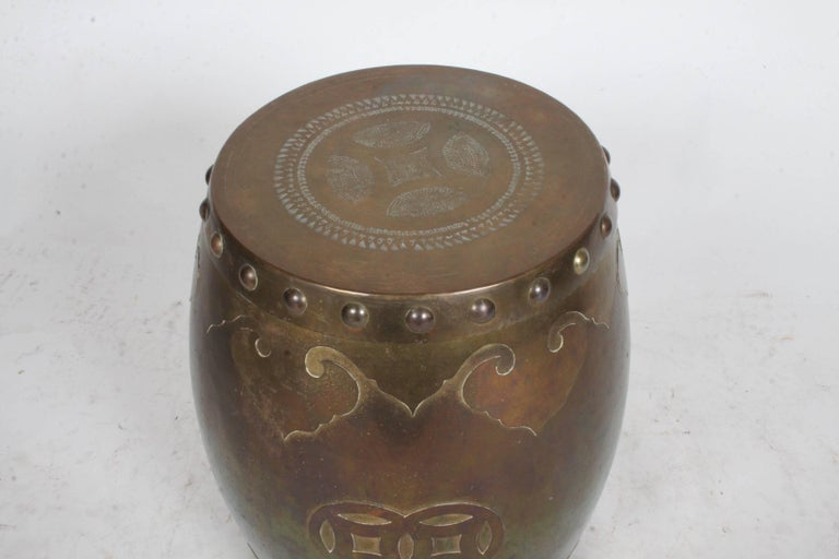 c. 1970s brass Asian style drum side table or stool with removable top for storage. Marked made in Hong Kong. Brass has nice patina.
