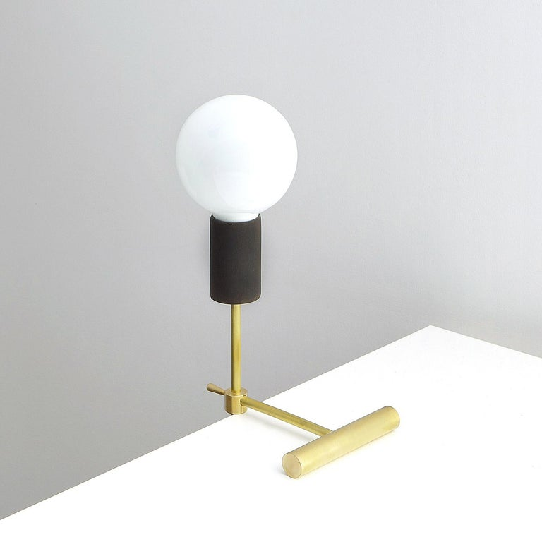 Solid brass table lamp by Olek Vojtek Handmade, adjustable desk light made of brushed brass and wood elements. Lamp maintains a balance on the edge of the table, shelves, etc. The height can be adjusted. The lamp can also stand on surface so it