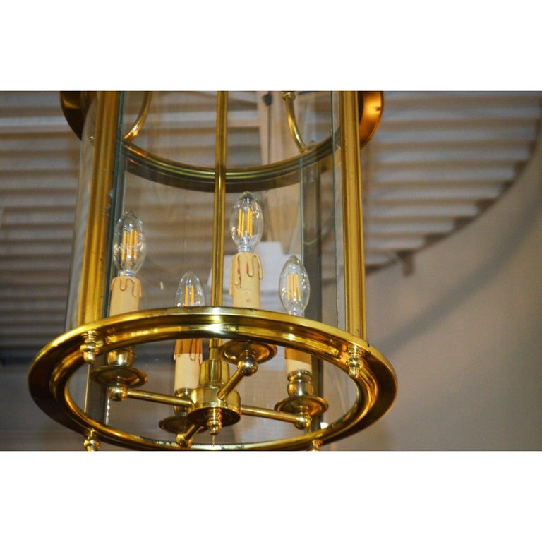 Solid brass lantern has the original glass cage in excellent condition. The drip candle holders are original and in excellent condition as well. The height is 27