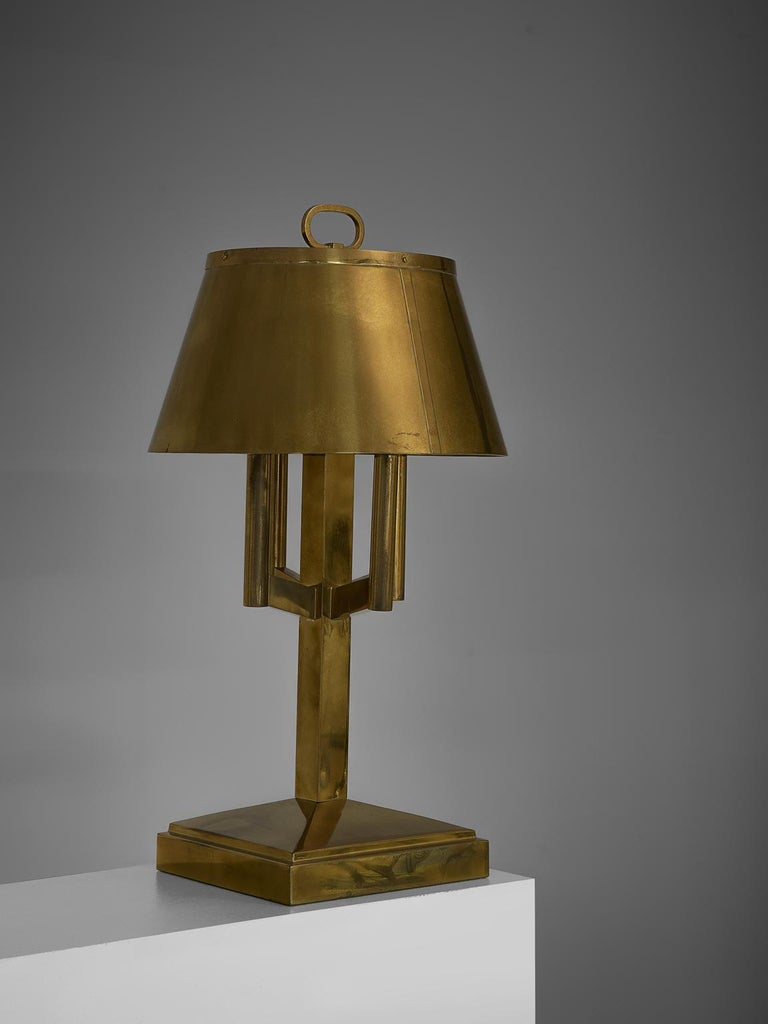 Table lights, brass, Italy, 1940s.  This strong and sturdy table lamp bears strong traits of the Classic shaded desk light. Yet the shades are combined with an strong, angular bases, giving them a modern aesthetic. These lamps have, due to time and
