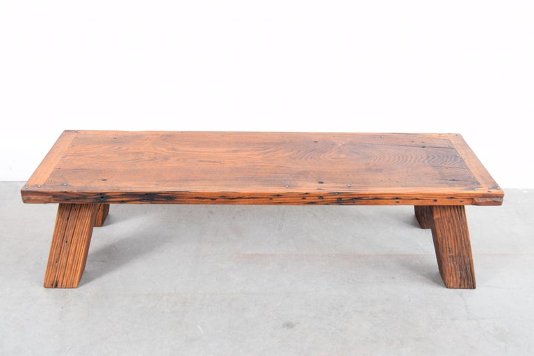 Coffee table constructed of re-claimed, solid North American chestnut. Very well constructed. One leg is notched out (a construction detail from whatever building this chestnut was salvaged from) on one corner. This Chestnut is likely 100 - 150