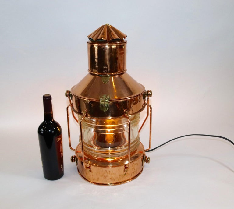 Highly polished and lacquered ships anchor lantern with a thick Fresnel lens [Please see the picture showing a piece of missing lens). Lantern has been electrified for home use. Weight is 19 pounds.
