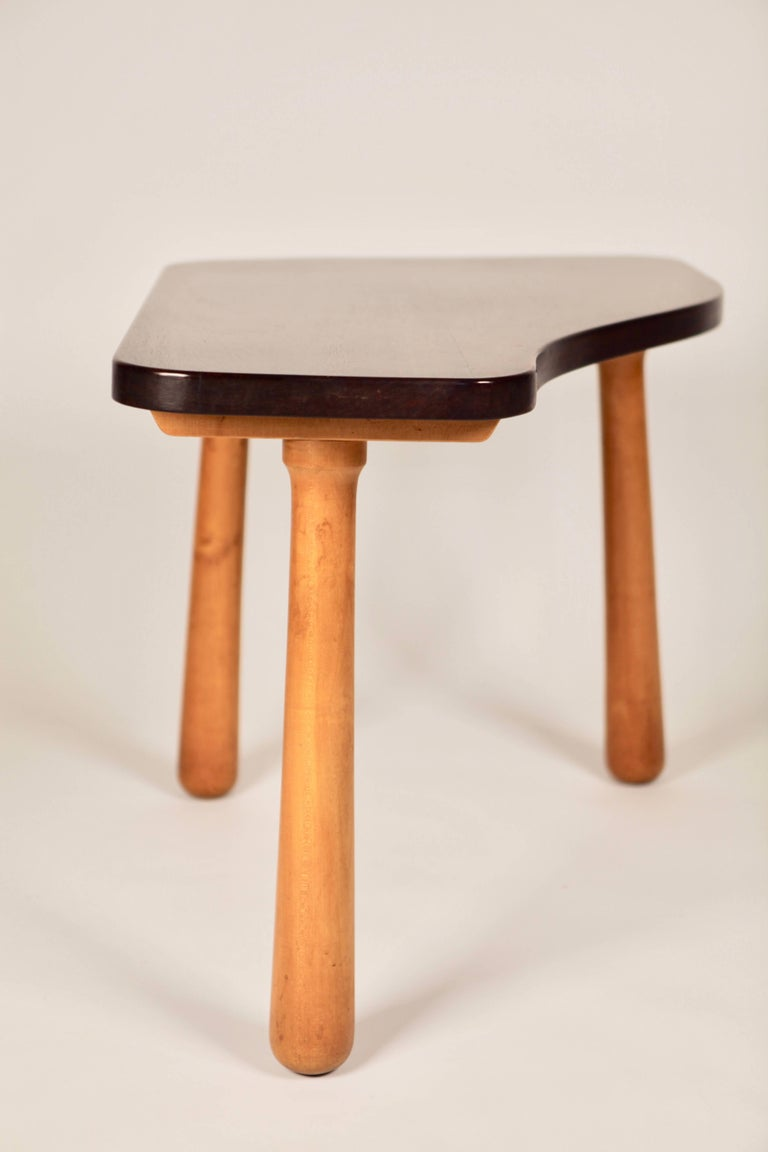 Organic shaped side or coffee-table with a solid Cuban mahogany top and birch oblong shaped legs. Probably designed by Philip Arctander.