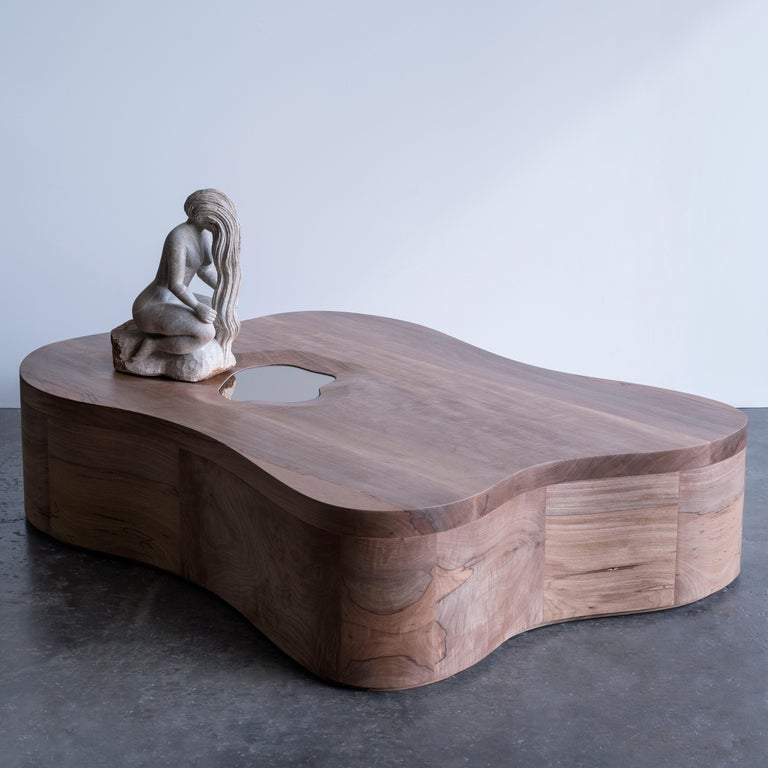 This central table was designed around the soapstone sculpture made by the master craftsman sculptor Expedito Jonas de Jesus. The women are recurrent in the Expedito's sculptures, as an homage to them, and the inspiration for the organic forms of