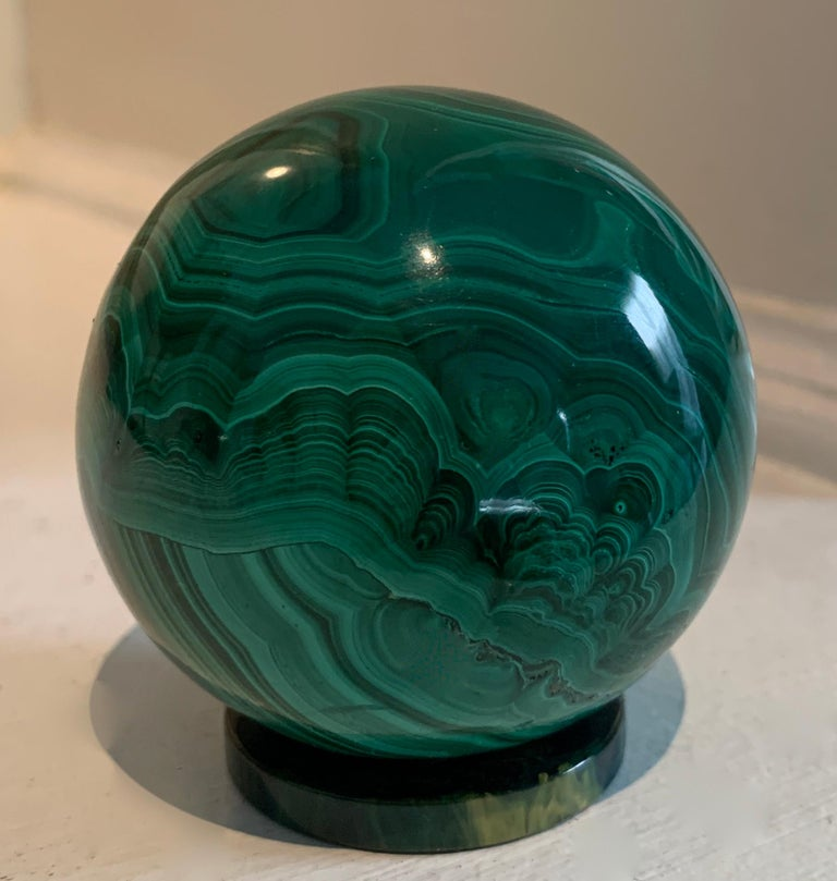 A malachite sphere / ball perfectly suited as an object d'arts for the desk as a stand alone or paper weight.  The piece is also wonderful for a collection of stones or malachite.  A very sexy piece - simple and architectural.  Russian malachite -