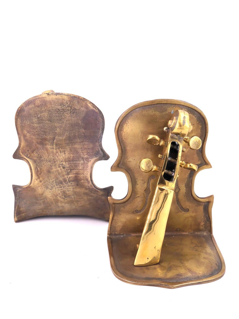 American Solid Pair of Polished Patinated Brass Cello Bookends For Sale