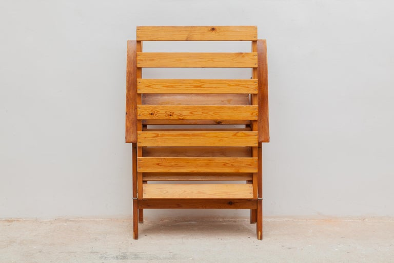 Vintage outdoor chairs. Solid wooden slat construction with armrests. Fold-able for easy storage. Dimensions: 63 W x 97 H x 78 D cm, seat 42 cm high.